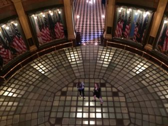 Two tourists exploring the glass floor in the central rotunda. Photo taken by Andy Chmura