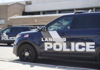 Lansing Police vehicles parked outside of the North Precinct Operations Center. Photo by Lukas Eddy.