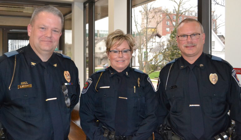 East Lansing police Chief Jeff Murphy (left) stands with Lt. Trisha Neff (middle) and Sgt. Tom Blank (right) after recognizing their promotion to supervisor at the April 11 City Council meeting.