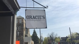 The sign for Gracie's Contemporary Bistro which is located just across the street from the Williamston Theatre.