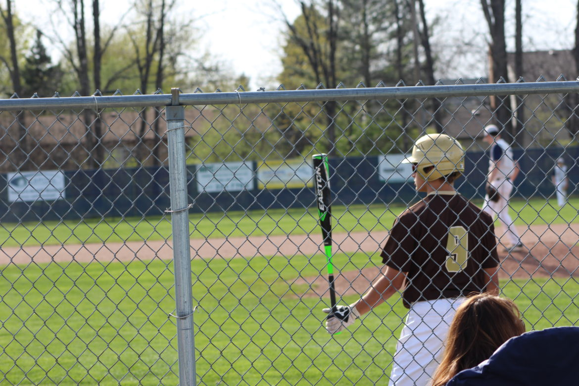 A Holt Rams JV baseball player waits to bat at their game against Dewitt April 24. Four of the coaching staff—between JV and Varsity—have left the team mid-season.