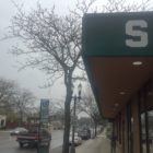 """The Michigan State """"S"""" is visible on the awning of the university's Center for Community and Economic Development on Michigan Avenue. The center is one of many outreach programs connecting MSU with its neighbor to the west. Photo by Maxwell Evans"""