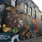 A large mural painted on the side of a building is one of the first things visitors to Old Town see. Photo by Kaley Fech.