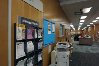 A wall of event information at the CADL Downtown branch. Photo by Lukas Eddy