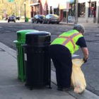 East Lansing worker with the newly installed bins