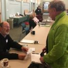 Election worker Joe Mika, left, signs in voter Stan Schulz in East Lansing's Precinct 16 at University United Methodist Church. At 10:15 a.m., Schulz became the 40th person to vote at the precinct. The church is adjacent to Red Cedar Elementary, scheduled to be the first school to get refurbished. A school board vote to close Red Cedar has been an issue since 2012.