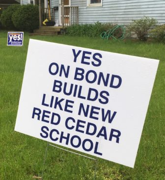 Signs supporting the bond issue were evident in the neighborhood around Red Cedar Elementary on election day.