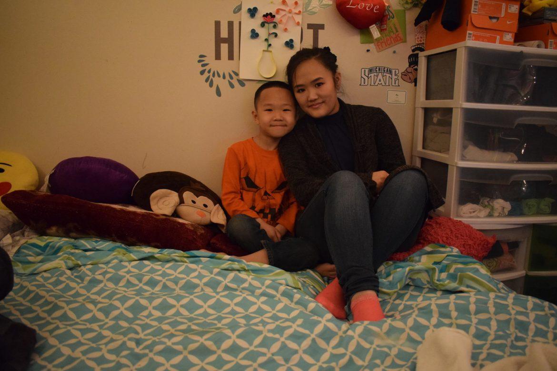 Hmong American Pa Vang and sibling.