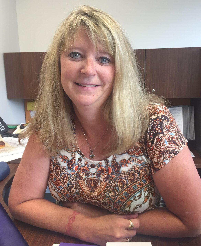 Lisa Roy at her desk