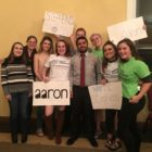 MSU students with signs surround candidate Aaron Stephens