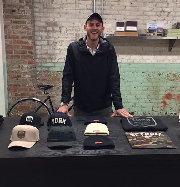 Josh York, of York Project, sets up a pop-up shop booth at Shinola in Detroit on Nov. 5, 2017.