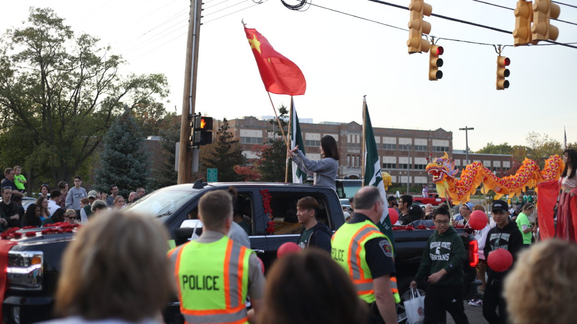 Police along the route of the 2017 Michigan State University homecoming parade