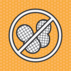 "Graphic depicting a ""no peanuts"" sign against an orange, polka dot background."