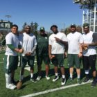 Coach Ron Burton and a few of his defensive lineman stop for a picture during the 2016 Michigan State Women's Clinic.