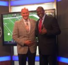 """Former Detroit Lions player Lomas Brown, right, and Rob Rubick pose on the set of """"Lions Live."""" Brown became a broadcaster as a way to stay connected with the sport he played since he was a child."""