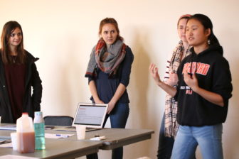 The executive board members of Spartan Body Pride give a presentation on tips to stay positive during Halloween.