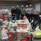 Employees of Jackson National Life deliver holiday presents to charity.