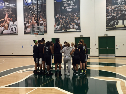 The Spartan women's basketball team gathers for a post-practice huddle with head coach Suzy Merchant.