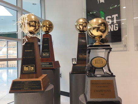 The Spartan women's basketball team displays championship trophies in the team's main office. Some of the credit for those trophies may go to the team's scout team.