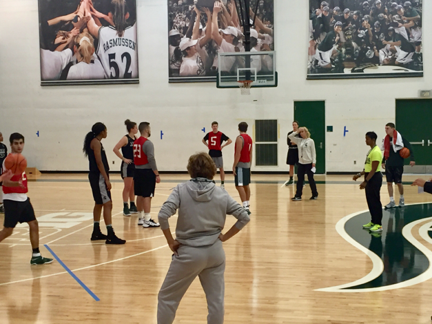 Michigan State University women's basketball assistant coach Maria Fantanarosa (closest) and head coach Suzy Merchant stop practice to instruct the scout team. It's the scouts job to help the basketball team prepare for future opponents.