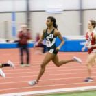 Taylor Mullins runs during a track meet.