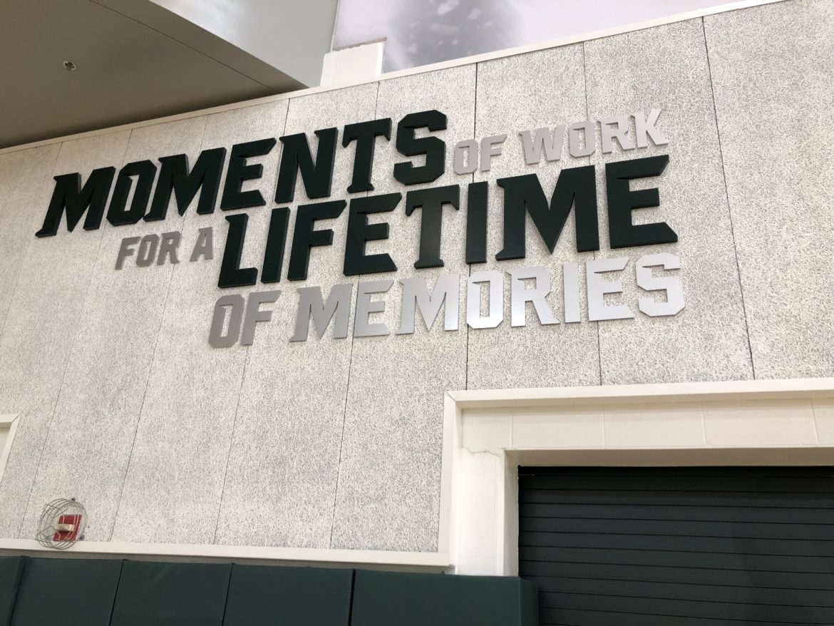 """Student-athletes sometimes turn their college experiences into coaching careers. The wall of the Michigan State basketball program's practice gym includes the phrase """"moments of work for a lifetime of memories."""""""