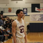 East Lansing senior Brandon Johns prepares for a recent basketball game. Johns plans to attend the University of Michigan.