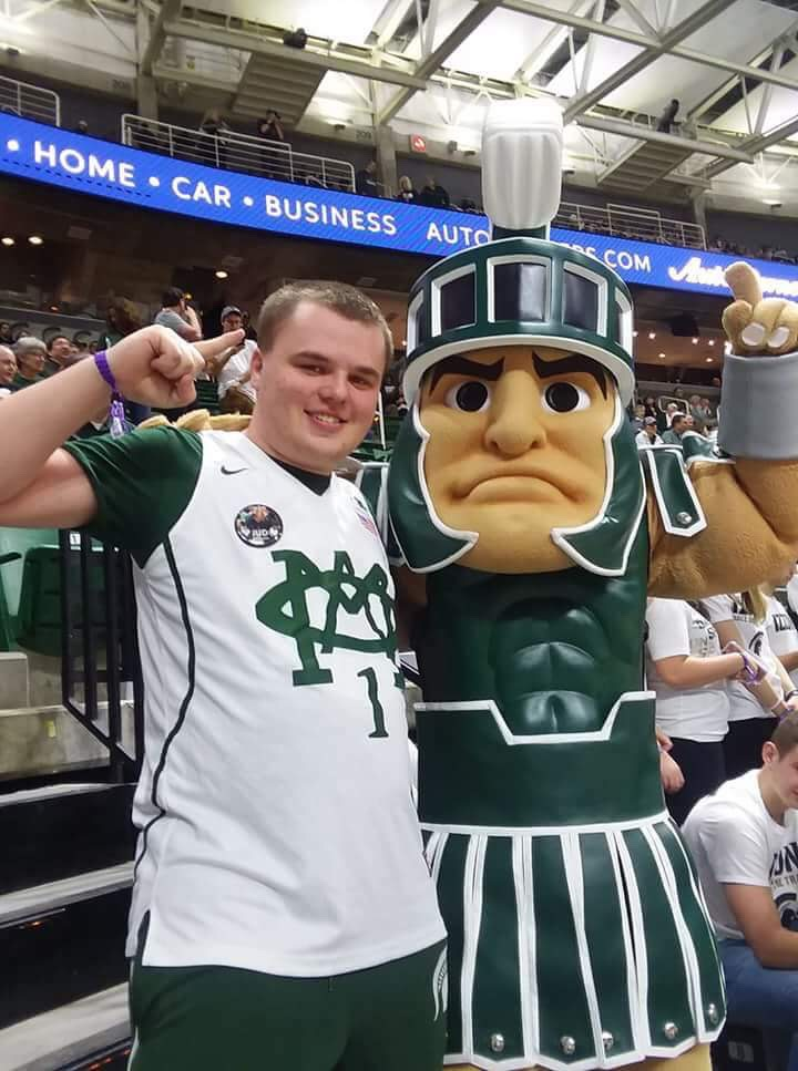 Michigan State University graduate student Mike Sterner contributes to many Spartan fan Facebook groups. He said he tries to limit attacks by fans on specific players.