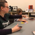 Parent Anna Montgomery playing with her daughter at the East Lansing Public Library's arts & crafts event.