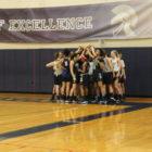 East Lansing girls basketball team huddles for team speech.
