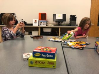 Anna Montgomery's two daughters enjoying the various game's at the East Lansing Public Library