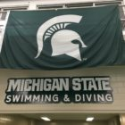 A Spartan flags hangs inside inside the MSU Swimming and Diving facility in IM West on April 4.