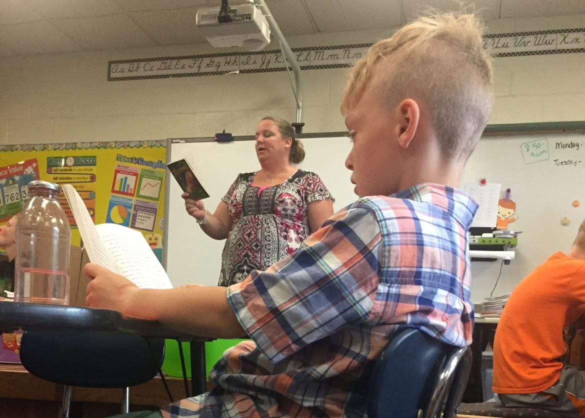 boy and teacher reading