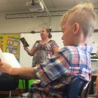 boy and teacher reading