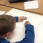 student creating a poster