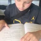 boy reading math book