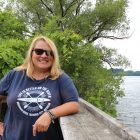 Tawny Miller of River Outfitters in Traverse City by the Boardman River. Credit: Naina Rao.