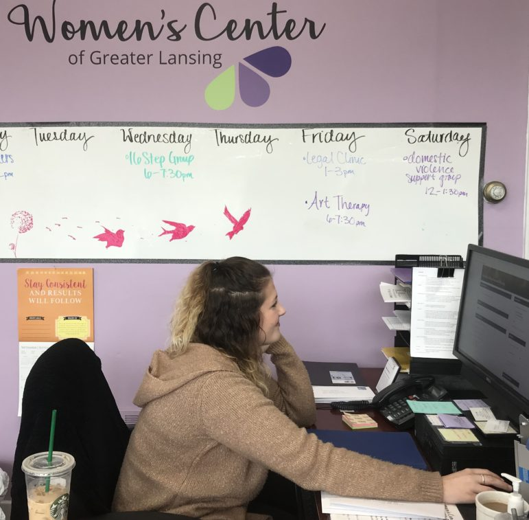 Kellie Lambie, a volunteer at the Women's Center of Greater Lansing, answers phones, creates appointments and interacts with clients. Lambie is the first person visitors see when they walk through the center doors.