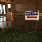 A sign points voters to the precinct at Lansing's Foster Community Center. Lansing voters were asked whether to annex about 11 acres of land from Delta Township.