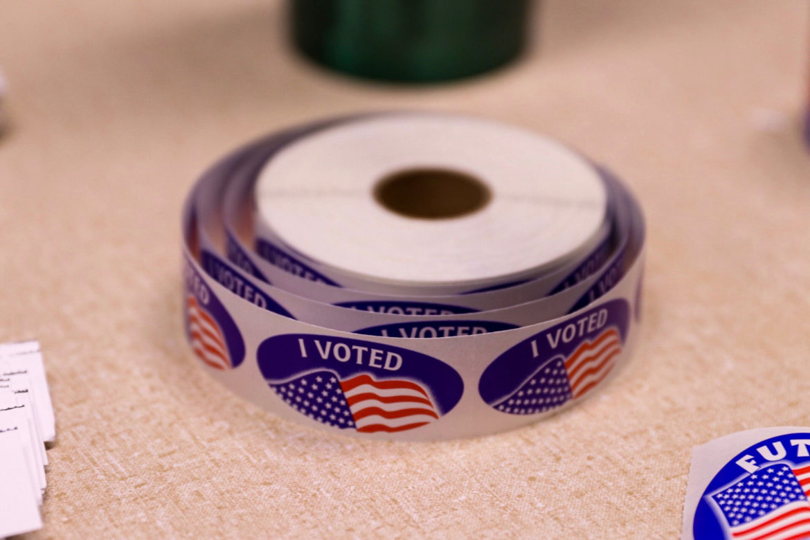 A role of stickers for voters sit on a table at a voting precinct in Delhi Township.