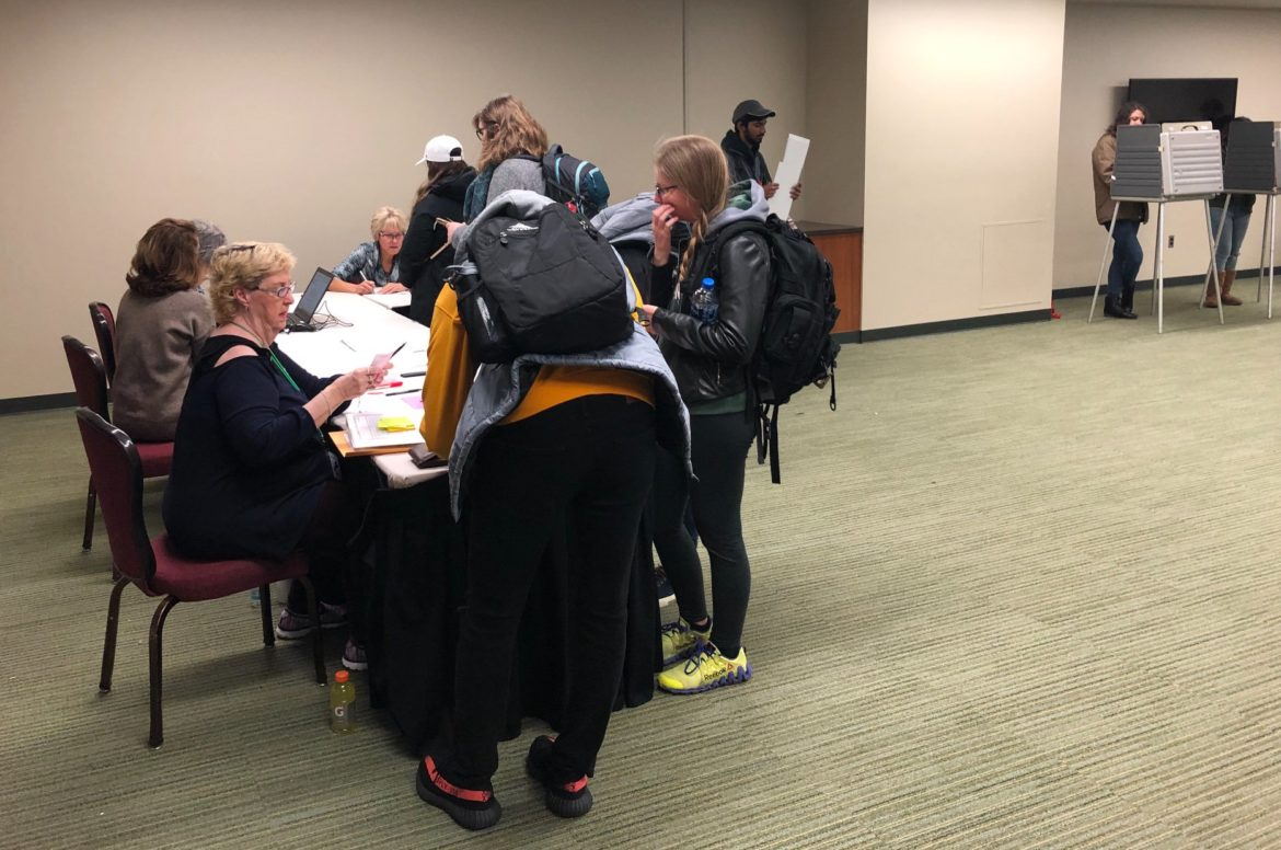 Voters check in at the voting precinct at the MSU Union. Voting at the remained at a steady pace throughout the day Tuesday.
