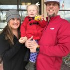 Mother, father and 2-year-old outside polling place.