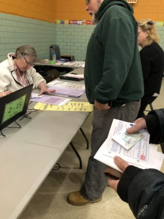Voters arrive at the voting precinct at Mount Hope Elementary School on Tuesday morning.