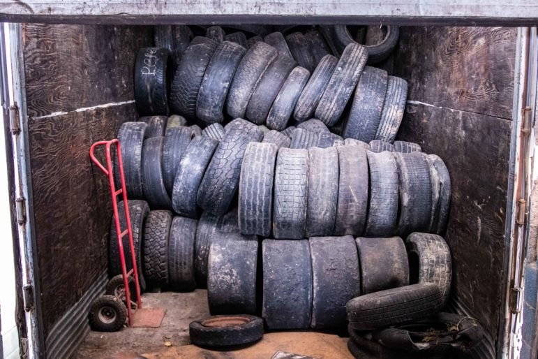 Tires to be recycled sit in a trailer outside the Lansing Recycling Center facility on Cedar Street on Dec. 12, 2018.