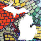 White map of Michigan superimposed on a colorful stained glass pattern