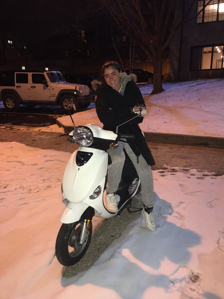 College student on white moped.