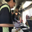 student working on food truck