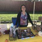 Liz Kruger displays her Bakes By Beth goods at the South Lansing Art Festival in October.