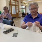 Grand Ledge area women meet to knit as part of the Crafting with a Cause group. They work on items such as blankets for those in need.