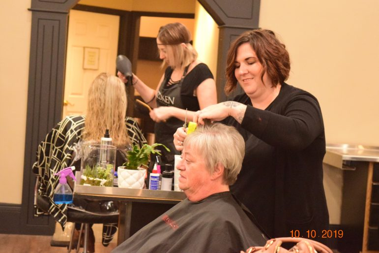 Stylists work with their respective clients.